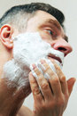 Closeup image mature man shaving Royalty Free Stock Photography
