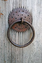 Closeup image of old door with circle iron door handle wooden Stock Photo