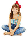 Closeup image pretty little girl sitting floor jeans isolated white background Stock Photos