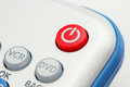 Closeup image of a red power button on a remote control Royalty Free Stock Photo