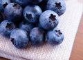 Closeup image of ripe blueberries on the fabric serviette Stock Images