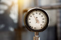 Closeup of industrial manometer measuring gas pressure on the plant Royalty Free Stock Photo