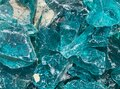 Closeup of isolated turquoise rough glas shards