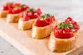 Closeup of Italian bruschetta with tomato, basil and garlic Royalty Free Stock Photo