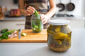 Closeup on jar of marinated cucumbers on table Royalty Free Stock Photo
