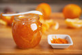 Closeup on jar with orange jam table Royalty Free Stock Image