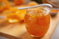 Closeup on jar with orange jam table Royalty Free Stock Photos