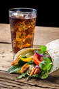 Closeup of kebab with fresh vegetables on black background Royalty Free Stock Photos