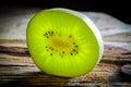 Closeup of kiwi slice on wood Royalty Free Stock Photo