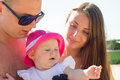 Closeup of little baby with parents. Royalty Free Stock Photo