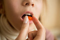 Closeup of little girl taking medicine in pill Royalty Free Stock Photo