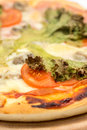 Closeup macro pizza slice with green lettuce and tomato Royalty Free Stock Photo
