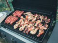 Closeup macro of raw meat barbecue chicken legs grill fire Royalty Free Stock Photo