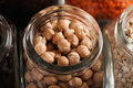 Closeup macro shot of chickpeas in glass jar Royalty Free Stock Photo