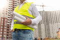 Closeup of male foreman holding rolled blueprints Royalty Free Stock Photo