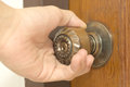 Closeup of male hand opening door knob Royalty Free Stock Photo