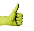 Closeup of male hand showing thumbs up sign against white background yellow skin Royalty Free Stock Photo