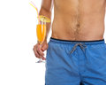 Closeup on male holding cocktail Stock Photos