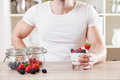 Closeup on man with delicious yoghurt with fresh berries Royalty Free Stock Photo
