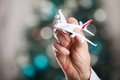 Closeup of man hand holding model of airplane Royalty Free Stock Photo
