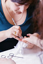 Closeup of a manicurist filing female s nails Royalty Free Stock Image