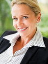 Closeup of a mature business woman smiling Royalty Free Stock Photos
