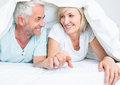 Closeup of a mature couple lying in bed portrait at home Royalty Free Stock Image