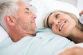Closeup of a mature couple lying in bed portrait at home Royalty Free Stock Photos
