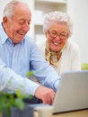 Closeup of a mature couple using a laptop Stock Image