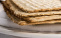 Closeup of matzah on plate which is the unleaven bread served at jewish passover dinners Stock Photo