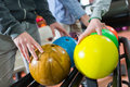 Closeup men choosing their bowling ball Royalty Free Stock Photo