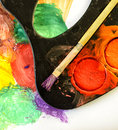 Closeup of messy used water color paint box and paint brush Royalty Free Stock Photos