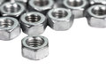 Closeup metal screw (bolt) and nuts on white background. Royalty Free Stock Photo