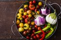 Closeup of metallic basket with fresh vegetables tomatoes eggplants and peppers Royalty Free Stock Photo