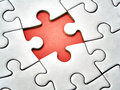 Closeup missing last piece white jigsaw puzzle Royalty Free Stock Photo