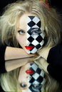 Closeup of model with a chess pattern on mirror Royalty Free Stock Photography