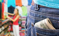 Closeup money pocket against girl clothing store Royalty Free Stock Photography
