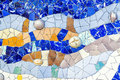 Closeup of mosaic of colored ceramic tile by Antoni Gaudi at his Royalty Free Stock Photo