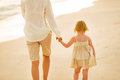 Closeup on mother and baby girl walking on beach Royalty Free Stock Photo