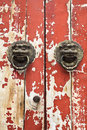 Closeup of the mottled old door and knocker Royalty Free Stock Photo