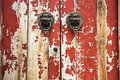 Closeup of the mottled old door with knocker Royalty Free Stock Photo