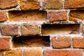 Closeup of old damaged brick wall with holes Royalty Free Stock Photo