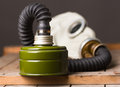 Closeup of old gas mask on wooden box Stock Photography