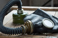 Closeup of old gas mask on wooden box Stock Image