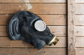 Closeup of old gas mask on wooden box Royalty Free Stock Image