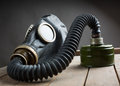 Closeup of old gas mask on wooden box Royalty Free Stock Images