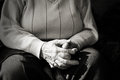 Closeup of an old woman s hands joined focus on Royalty Free Stock Photography