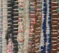 Closeup old woven rag rug worn out Stock Photography