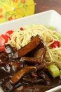 Closeup oriental dish meat noodles veggies Royalty Free Stock Photography
