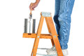 Closeup painter standing ladder dipping his brush paint can man unrecognizable white background Royalty Free Stock Photo